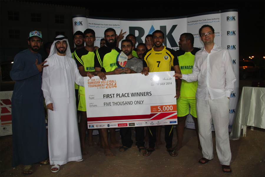 imgRAK FTZ awarding Mena Cool, the first-place winners in the 4th RAK FTZ Ramadan Volleyball Tournament